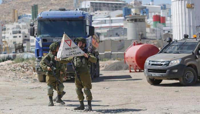 Israel bars all Palestinians after Tel Aviv attack: Army