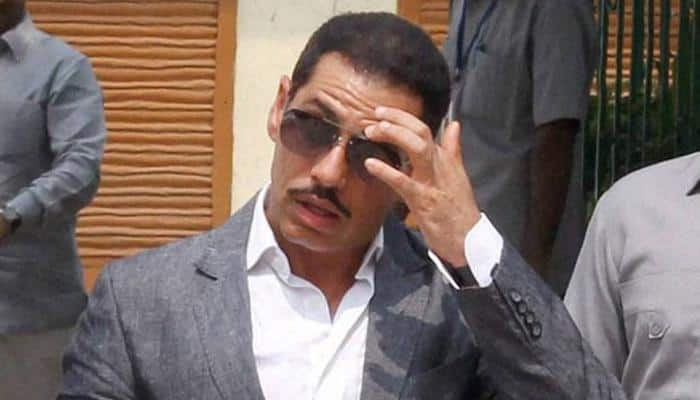 Congress accuses Justice Dhingra, who is probing Robert Vadra land deal cases, of taking undue favours
