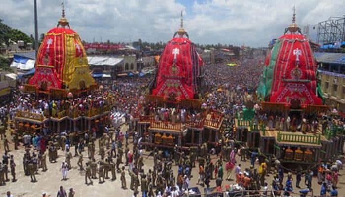 Artist makes miniature chariots for deities on Rath Yatra