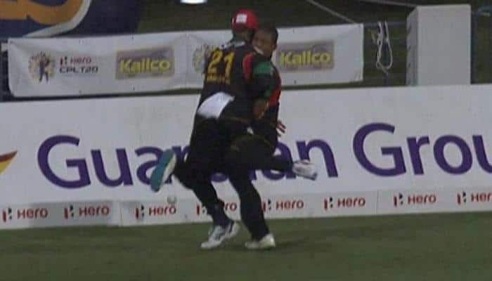 VIDEO: NASTY! Ambulance called after shocking head clash between fielders in CPL