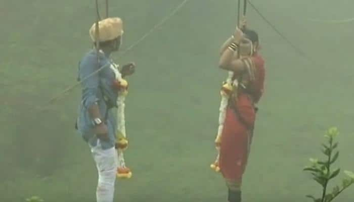 OMG! This couple tied the knot on a ropeway - WATCH this video of never-seen-before marriage