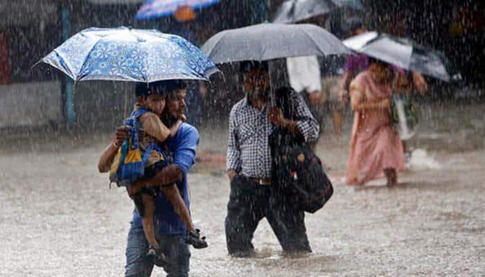 Heavy rains lash Mumbai, disrupt road, rail, air traffic; IMD issues alert