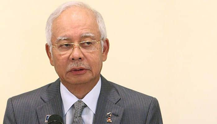 It`s official: Malaysia PM outed as key scandal figure