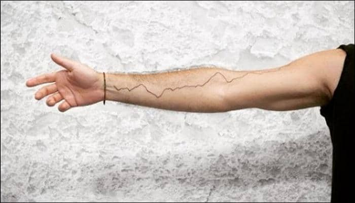 Pledge for change: NYC artist collaborates with NASA; gets Earth's surface temperature tattooed!