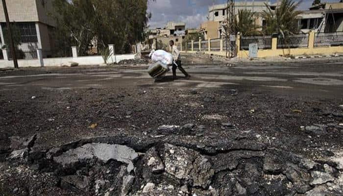 Raids set rebel areas of Syria's Aleppo ablaze as fighting rages