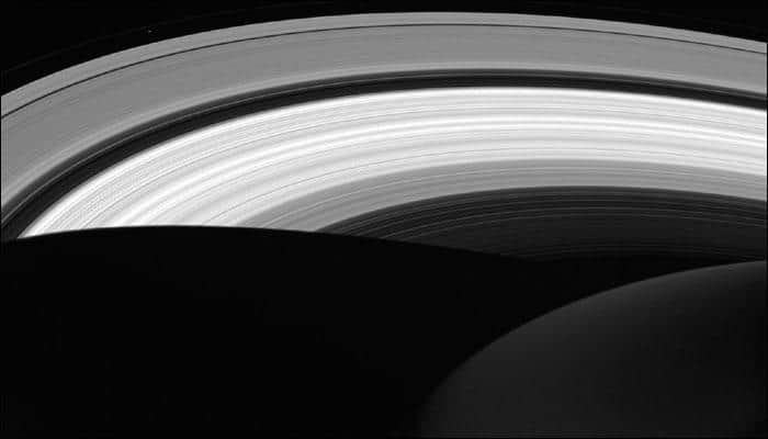 NASA's Cassini captures Saturn's rings in the daylight on the planet's nightside! - See pic