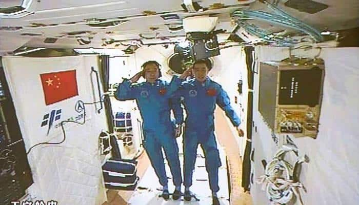 Chinese astronauts set foot in space station as Shenzhou-11 docks with Tiangong-2 orbital lab