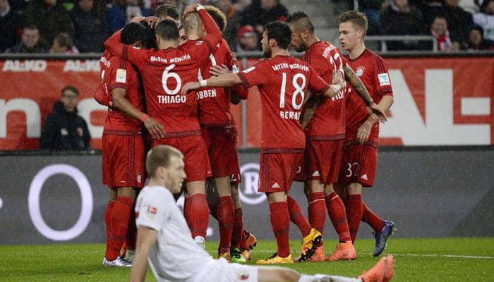 DFB Pokal: Holders Bayern Munich outmuscle Augsburg, Borussia Dortmund progress on penalties