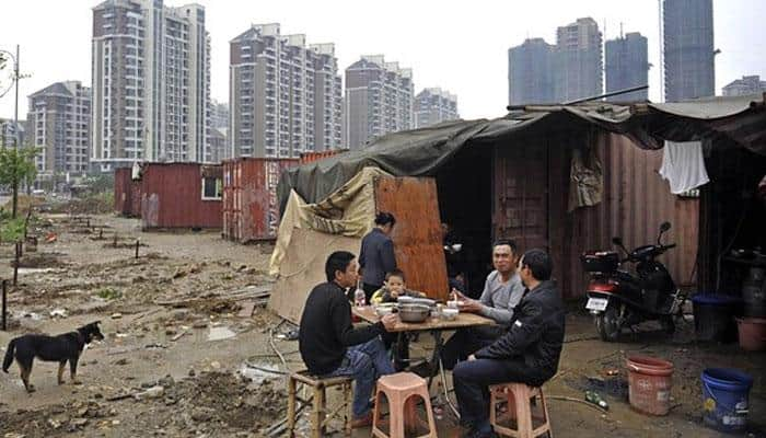 China to invest $140 billion to relocate poor citizens to more developed areas
