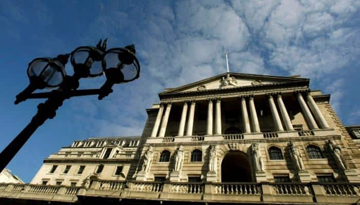 Bank of England raises UK growth forecast, holds rate