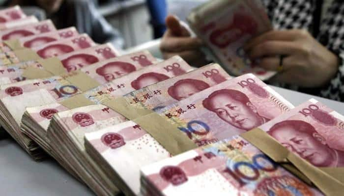 Chinese yuan at 8-year low after US Fed raises key interest rate