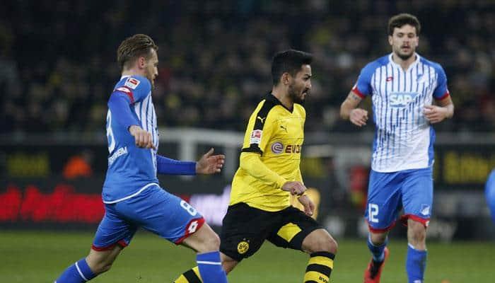 10-man Borussia Dortmund fight back to salvage a 2-2 draw against Hoffenheim