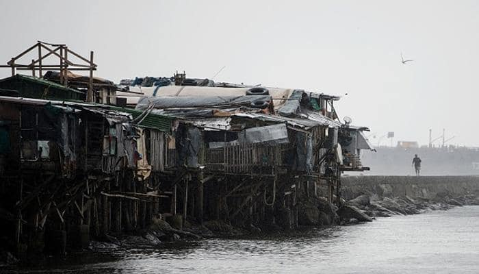 Typhoon eases but Philippines braces for floods, mudslides; 2 dead