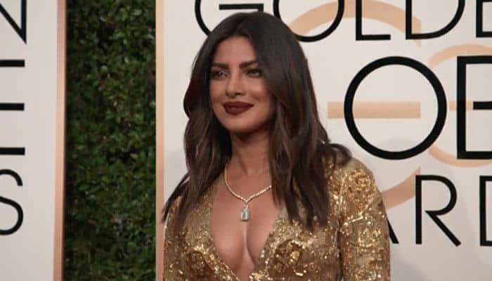 Golden Globes 2017: Priyanka Chopra shimmers in gold, looks stunning – WATCH