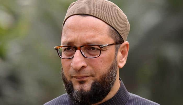 Angry Muslims beat Asaduddin Owaisi's effigy with shoes, burn it for dividing minority votes in UP - WATCH