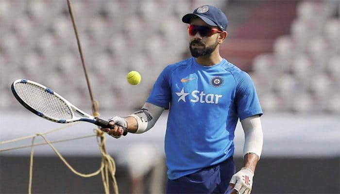 Recuperating Virat Kohli captured honing new skills — PHOTO
