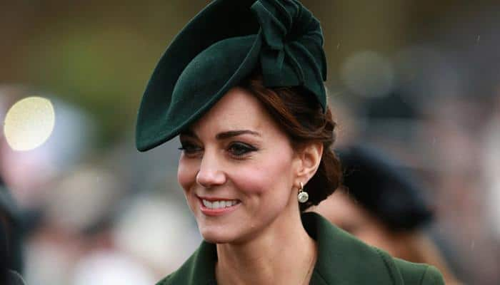 French prosecutor seeks hefty fines over topless shots of Prince William's wife Kate