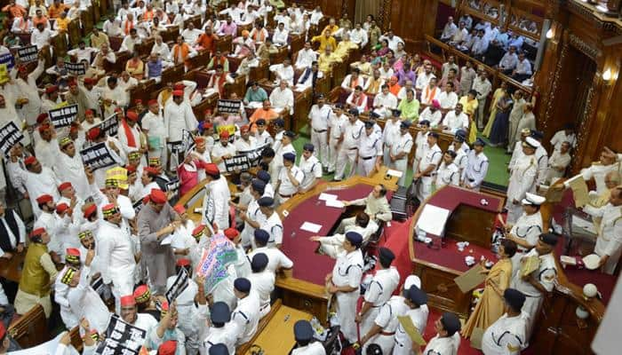Stormy start to UP Assembly session; SP, BSP MLAs stage protest, throw paper balls at Governor