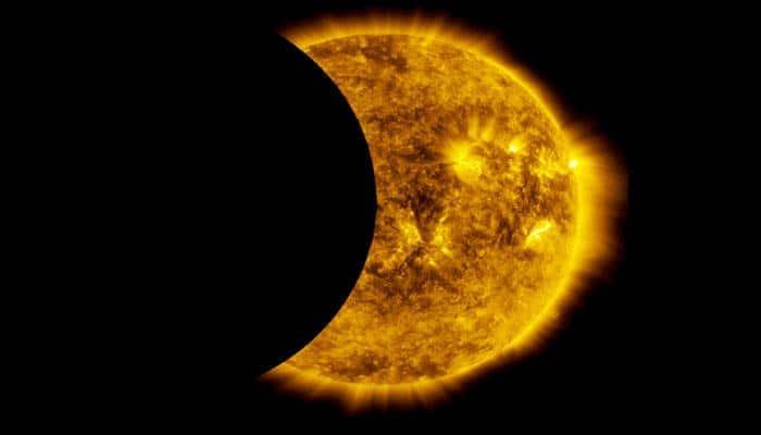 NASA's SDO catches the moon crossing the sun in a partial lunar eclipse!