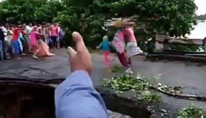 Bihar floods: Family of three washed away in bridge collapse | Watch video