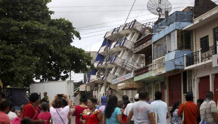 Deadly quake, hurricane a one-two punch for Mexico; 66 die