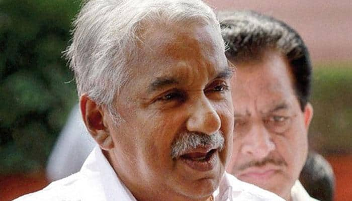 Oommen Chandy government decision to accept land tax scraped