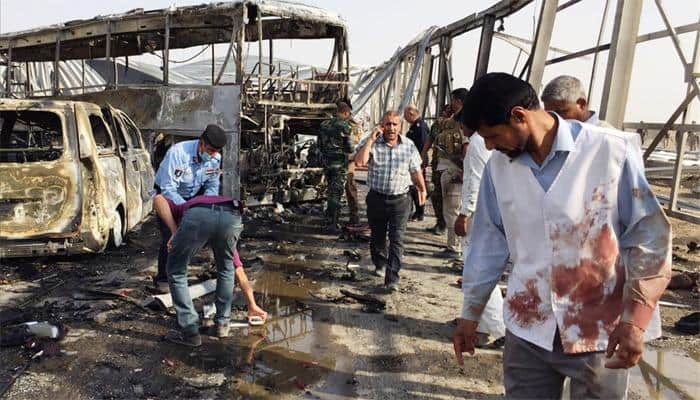 Suicide attacks on restaurants, checkpoint, kill 60 in southern Iraq