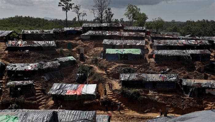 Myanmar looks for more Hindu corpses as mass grave unearthed