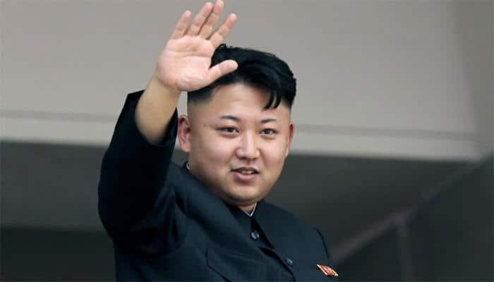 North Korea's Kim promotes sister, reaffirms nuclear drive