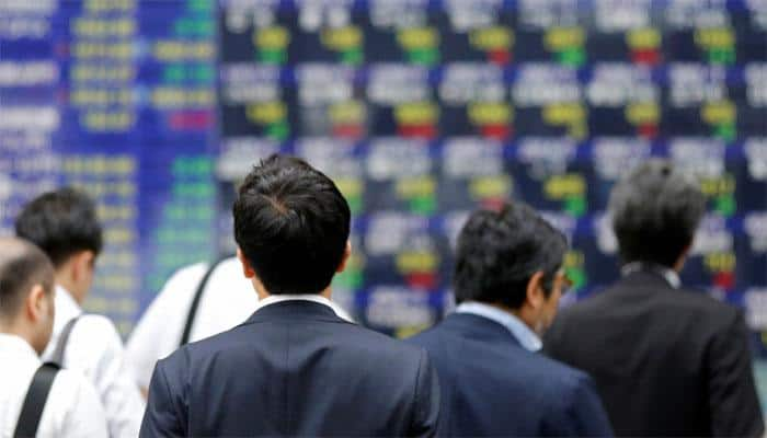 Japan's Nikkei closes at 21-year high on positive US cues