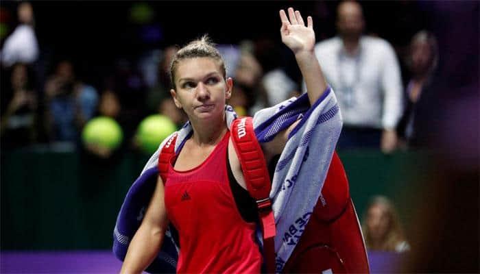 WTA Finals: Top-ranked Simona Halep crashes out, Caroline Garcia stuns Caroline Wozniacki to reach last four