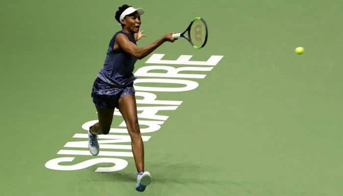 Patient Venus Williams rises over improved Caroline Garcia at WTA Finals