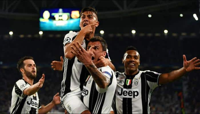 Juventus beat self-destructing Chievo to go top of Serie A