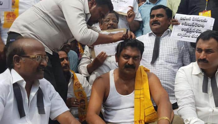Miffed over budget allocation for Andhra, TDP MLA Bode Prasad gets head tonsured