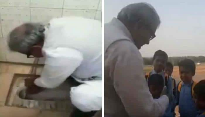 BJP MLA cleans toilet seat with bare hands, cuts students' nails as part of Swachh Bharat mission - Watch