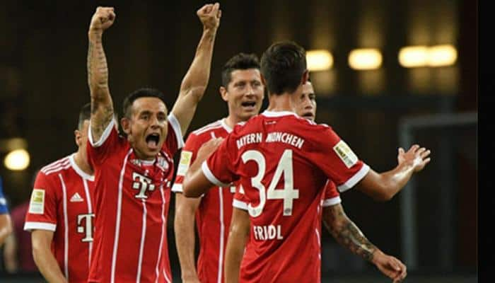Thomas Mueller, Robert Lewandowski doubles power Bayern Munich to complete rout of 10-man Besiktas in Champions League