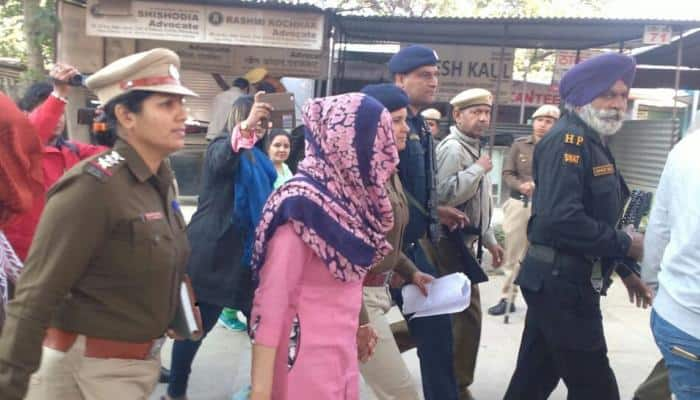 'Papa's angel' Honeypreet Insan, donning pink suit, appears before Panchkula Court