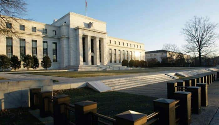Federal Reserve raises rates, signals confidence in strengthening economy