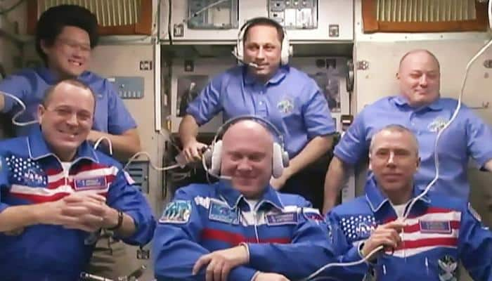 Expedition 56 crew members welcomed aboard the space station
