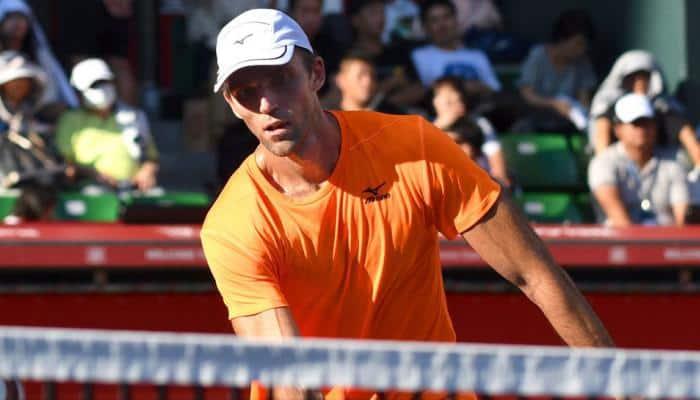 Karlovic beats former Barcelona Open tennis champion Robredo