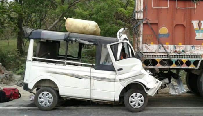 Shocking photo: Mini van rams into stationary truck, nine dead