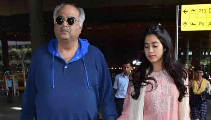 Janhvi Kapoor walks hand-in-hand with father Boney as they arrive back in Mumbai