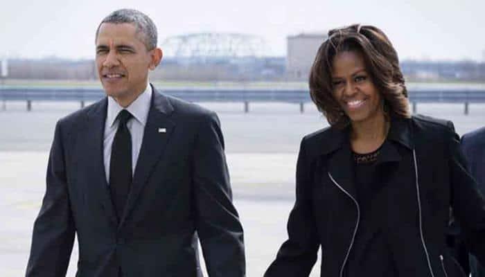 Netflix says it has signed Barack and Michelle Obama