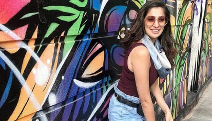 South sensation Raai Laxmi exudes oomph while posing with superbike—Pics