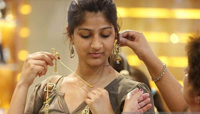 Gold weakens on muted demand; silver recovers