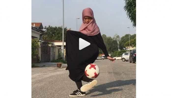 Is it Messi or Ronaldo? No, a burqa-clad girl displaying football tricks -Watch