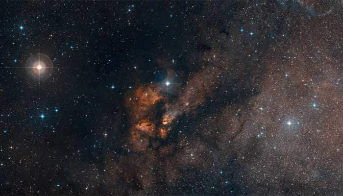 Dust-shrouded stellar cluster, with hundreds of young, hot and massive stars spotted- In pics