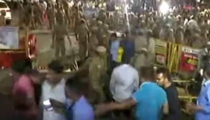 Well-wishers of M Karunanidhi lathi charged outside Chennai hospital