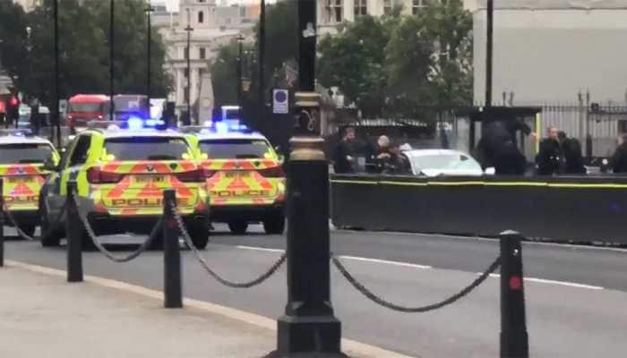 Car crashes into UK parliament barriers, several pedestrians injured