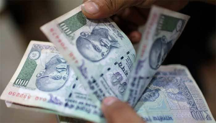 Rupee again breaches 72-mark, down 81 paise in early trade